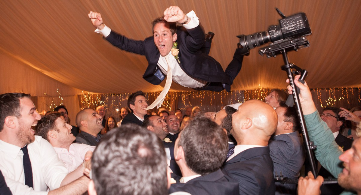 male jewish dancing, men throwing groom in air.